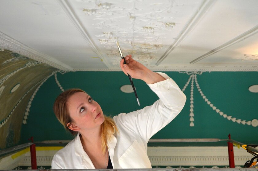 This undated handout photo provided by Mount Vernon shows Amelia Jensen working on New Room ceiling near the palladian window at George Washington's Mount Vernon, Va. estate. The keepers of Washington's Mount Vernon estate on Friday announced a major reinterpretation of the largest room in the Foun