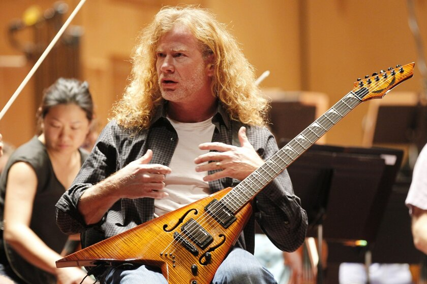 Dave Mustaine of Megadeth rehearses with the San Diego Symphony for Saturday's Symphony Interrupted concert.