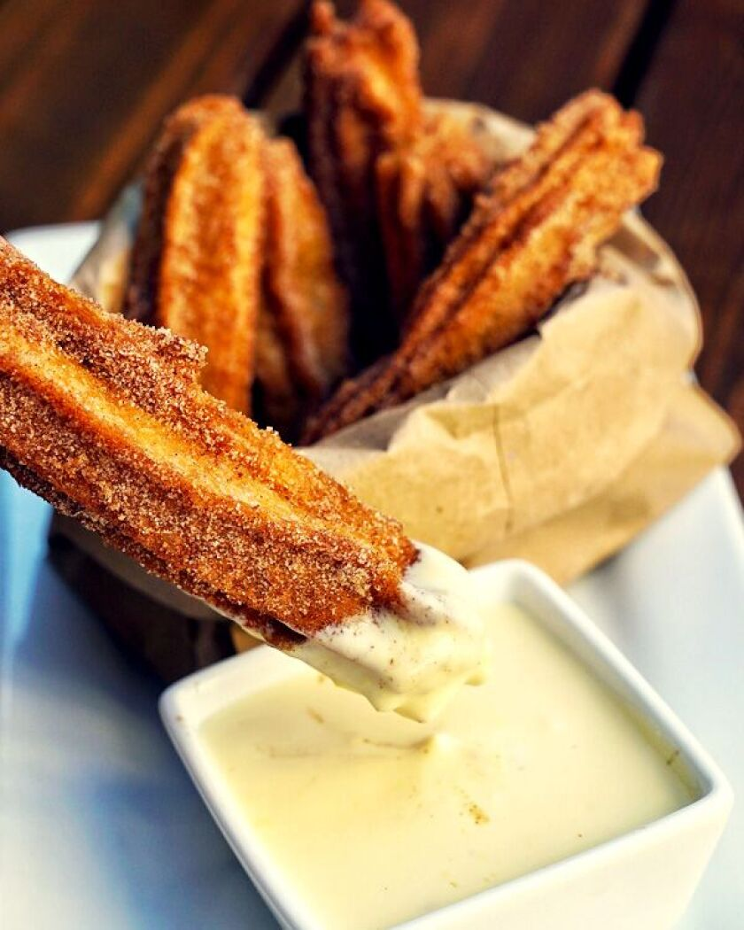 Blind burro makes gourmet churro dough with cinnamon water, then offers a creme Anglaise sauce for dipping.
