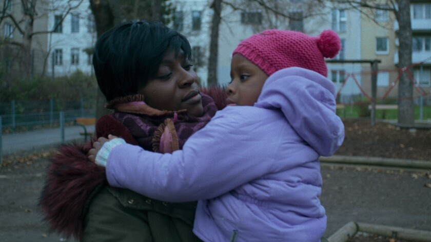 """Anwulika Alphonsus (left) **Child (right) not identified** in a scene from the movie """"Joy."""" Credit:"""
