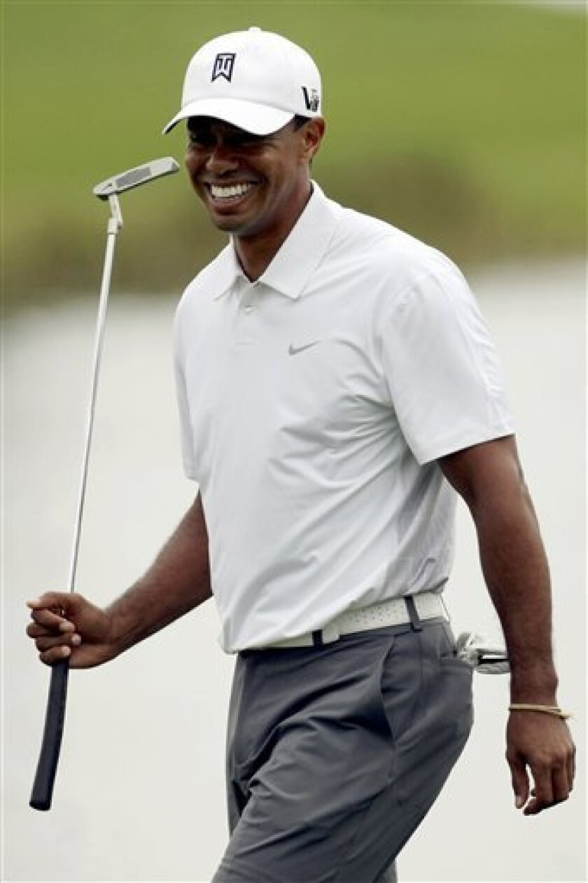 Tiger Woods walks along the fairway of the 16th hole during the pro-am at the Honda Classic golf tournament, Wednesday, Feb. 27, 2013, in Palm Beach Gardens, Fla. (AP Photo/Palm Beach Post, Bill Ingram)  MAGS OUT; TV OUT; NO SALES