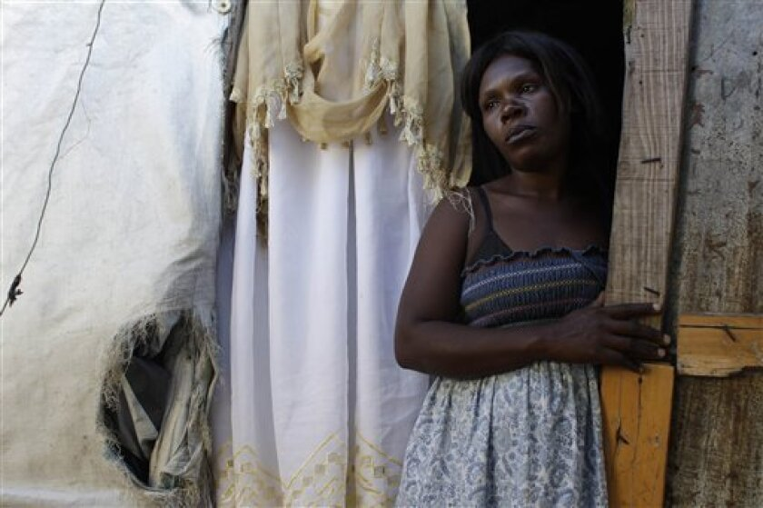 In this Jan. 1, 2012 photo, Mamoune Destin, 33, wife of Meristin Florival, stands in their tent at the Beaubin camp for people displaced by the powerful 2010 earthquake in Petionville, Haiti. Two years afterwards, more than half a million Haitians are still homeless, and many who have homes are worse off than before the Jan. 12, 2010 quake, as recovery bogs down under a political leadership that has been preoccupied with elections and their messy aftermath. (AP Photo/Dieu Nalio Chery)