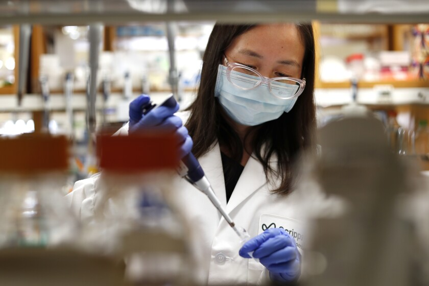 Jenny Hu, a senior staff scientist, prepares proteins at Scripps Research in La Jolla.