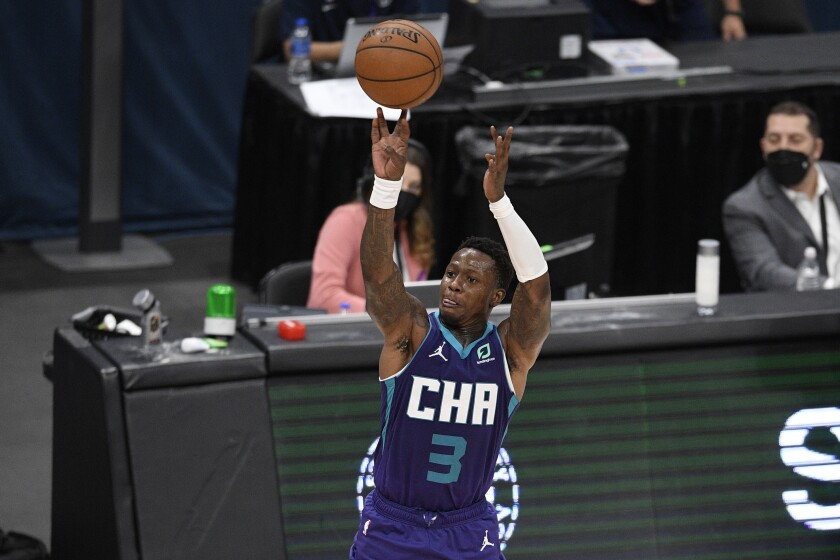 Charlotte Hornets guard Terry Rozier (3) shoots during the second half of an NBA basketball game against the Washington Wizards, Sunday, May 16, 2021, in Washington. (AP Photo/Nick Wass)