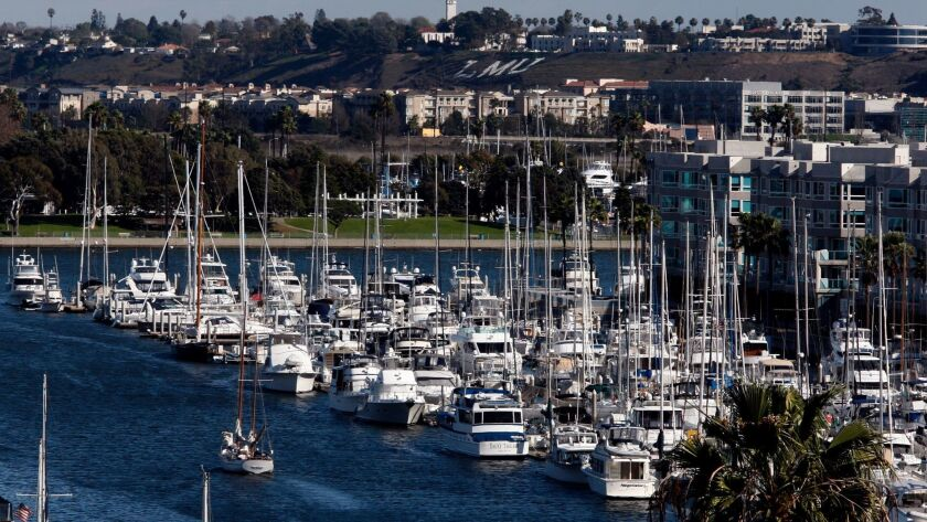 LOS ANGELES, CA-FEB. 2, 2014: A sailboat motors through Marina del Rey Harbor, which is home to mor