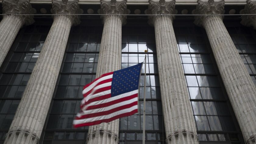 FILE- In this April 24, 2018, file photo, an American flag flies outside the New York Stock Exchange