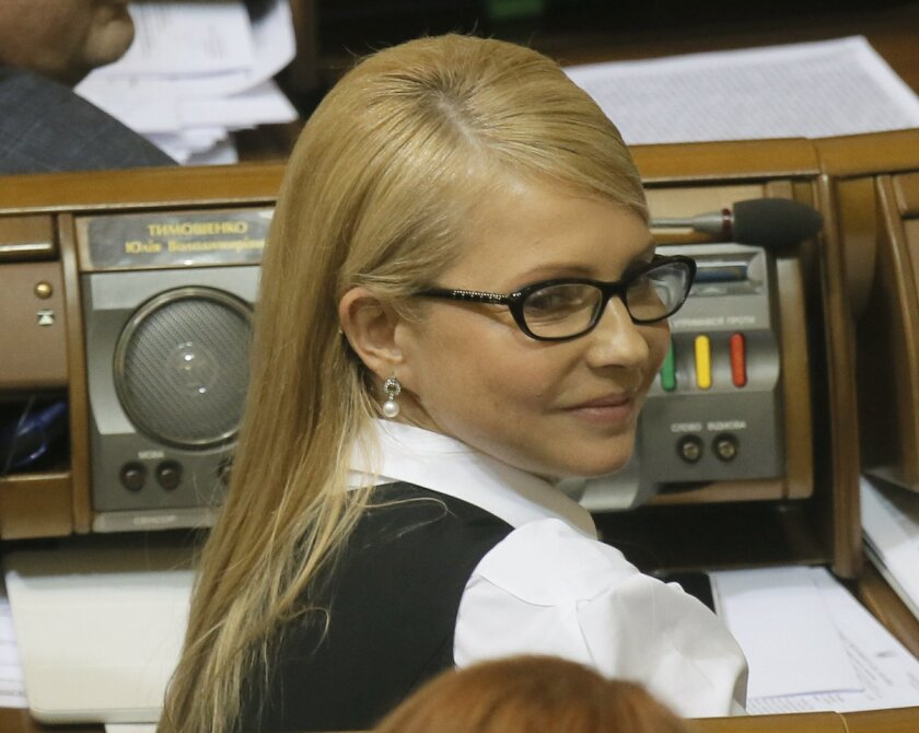 Yulia Tymoshenko, former prime minister and Fatherland party leader with a new hairdo during Parliament session in Kiev, Ukraine, Tuesday, Feb. 16, 2016.   Ukraine's President Petro Poroshenko called on the country's embattled prime minister to resign, a move that would break apart the fragile ruli