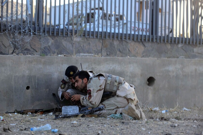 Afghanistan security forces take up a position after an attack on the U.S. Consulate in Herat early Friday.