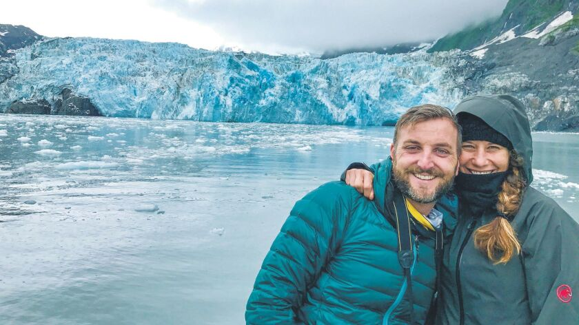 Benjamin Myers and Marlise Kast-Myers celebrate the last day of their motorcycle road trip with the 26 Glacier Cruise outside of Whittier, Alaska.