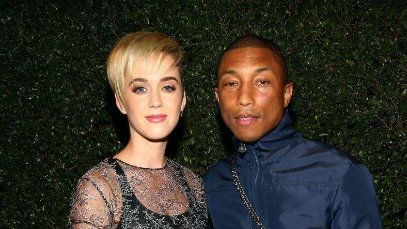 Mandatory Credit: Photo by Katie Jones/WWD/REX/Shutterstock (8584078ae) Katy Perry and Pharrell Wil