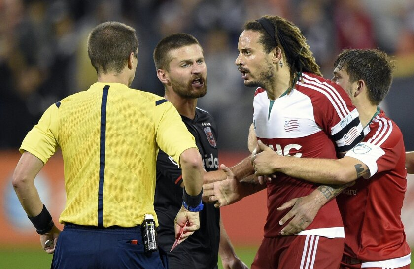 """FILE - In this Oct. 28, 2015, file photo, New England Revolution midfielder Jermaine Jones, second from right, is restrained by teammate Kelyn Rowe , right, and D.C. United midfielder Perry Kitchen, second from left, after he was given a red card and ejected during the second half of an MLS playoff soccer game in Washington. U.S. national team defender Jones is frustrated and angry about a six-game suspension that he says is making it tough to leave Major League Soccer. Jones is out of contract after spending last season with the Revolution, and he says his latest MLS contract offer is """"a joke.""""(AP Photo/Nick Wass, File)"""