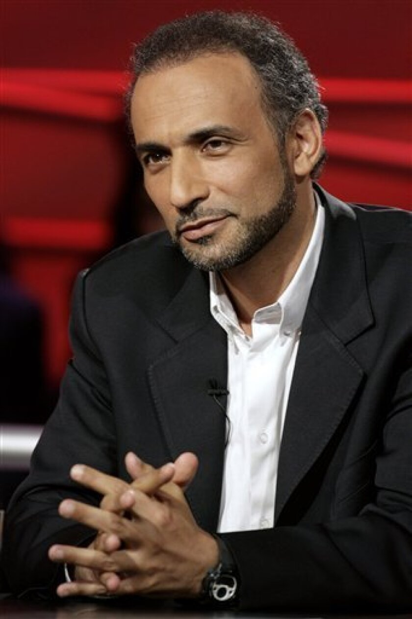 FILE - In this May 8, 2007 file photo, Islamic scholar Tariq Ramadan speaks during a debate at the Swiss Television in Geneva, Switzerland. A Dutch university fired Islamic scholar Tariq Ramadan on Tuesday for hosting a show on Iran's state television, which the school said could be seen as endorsing the regime. Ramadan, known as a reformist who condemns terrorism, seeks to modernize sharia law and urges Muslims living in Europe to integrate has recently been criticized in the Dutch press for allegedly voicing more conservative views for Muslim audiences than he does in the West. (AP Photo/Keystone, Salvatore Di Nolfi, File)