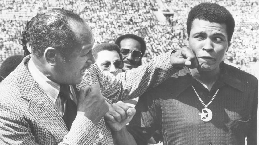 Tom Bradley punches Muhammad Ali