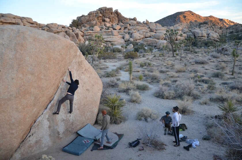A group of boulder-lovers gathers near Barker Dam in Joshua Tree National Park. Photo taken in 2012.