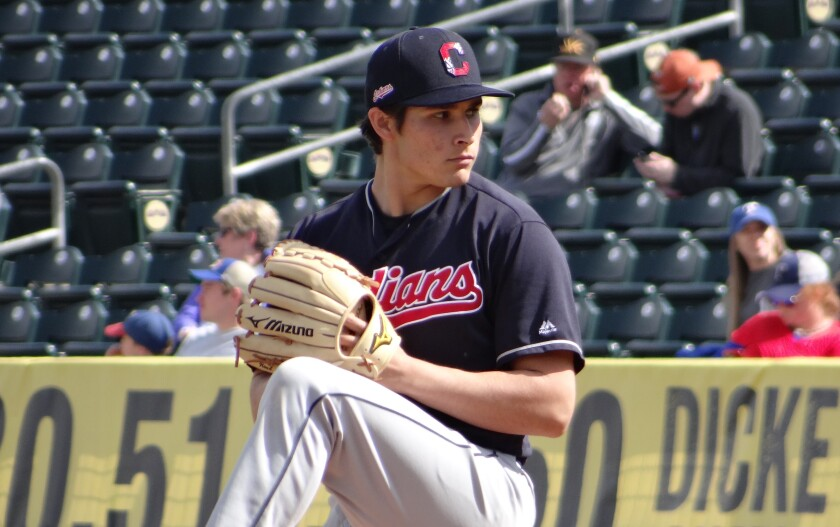 Cleveland Indians prospect Eli Morgan pitches during a spring training game.