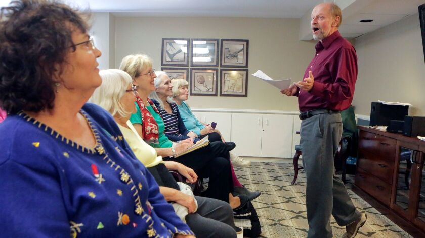 David Lewis of Vista teaches a music appreciation class to seniors at the Las Villas de Carlsbad assisted living center on Wednesday.
