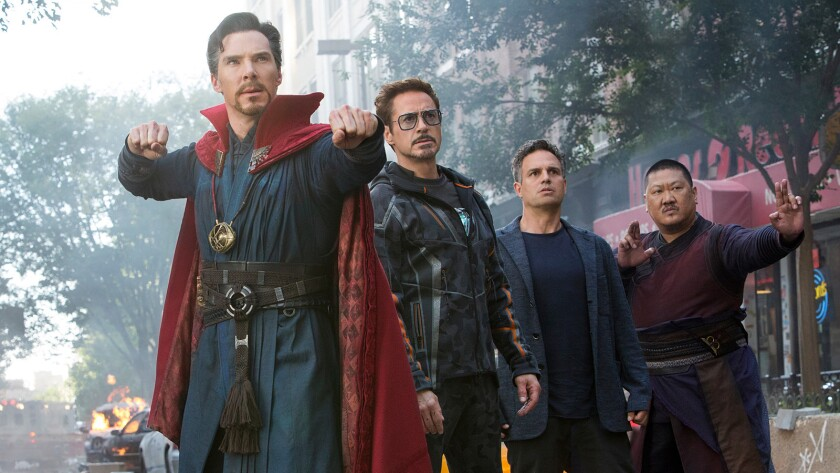 FILE - This file image released by Marvel Studios shows, from left, Benedict Cumberbatch, Robert Dow
