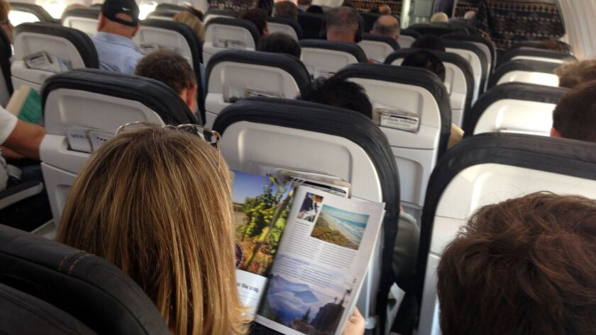Passengers fill an Alaska Airlines flight. The Seattle-based carrier plans to launch a bare-bones fare that limits passengers' seat choices.