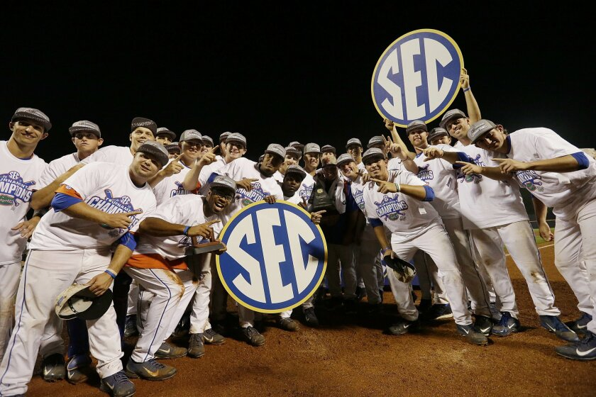 Florida gather after winning against Vanderbilt during the Southeastern Conference NCAA college baseball tournament championship game at the Hoover Met, Sunday, May 24, 2015, in Hoover, Ala. Florida won 7-3. (AP Photo/Butch Dill)