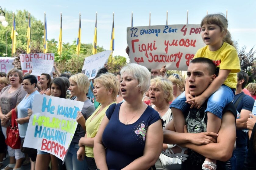 Relatives of Ukrainian military servicemen protest in Kiev as the country continues to fight pro-Kremlin forces in the east.