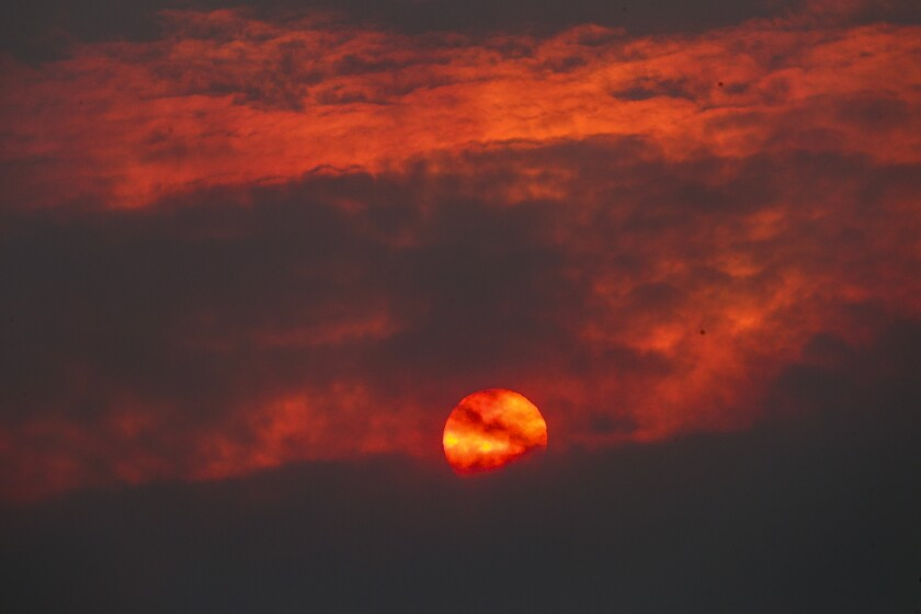A view of the sunset obscured by heavy smoke from the Bobcat fire as seen from Littlerock, Calif., on Friday.