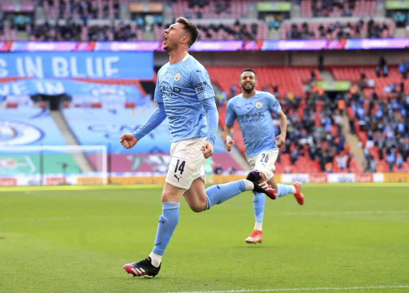 Manchester City's Aymeric Laporte celebrates scoring their side's first goal of the game during the English League Cup Cup Final against Tottenham Hotspur at Wembley Stadium, London, Sunday April 25, 2021. (Adam Davy/PA via AP)