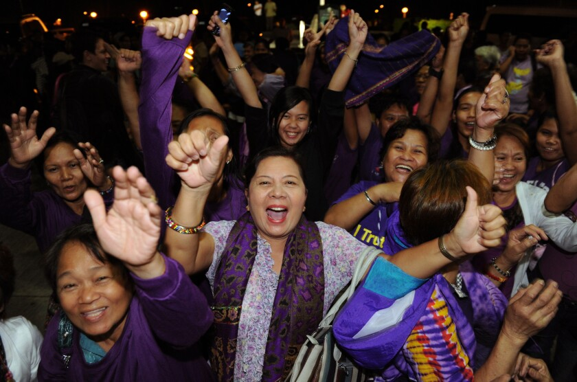Supporters celebrate passage of the reproductive health bill in the Philippines' House of Representatives in December.