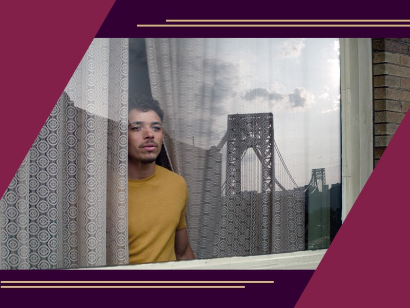 Anthony Ramos looks out a window.
