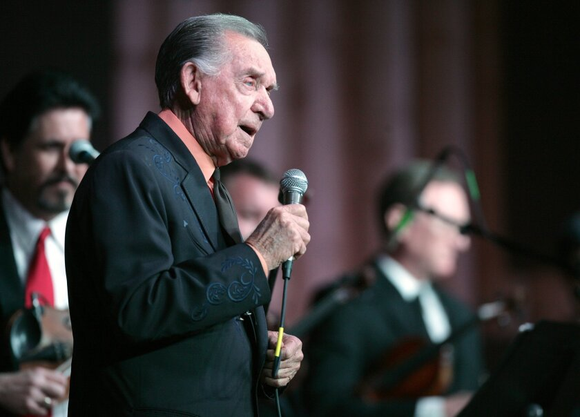 In a Jan. 7, 2011, file photo, Country Music Hall of Fame member and Grammy Award winner Ray Price celebrates his 86th birthday by performing in Bullard Texas. Price died Monday, Dec. 16, 2013. He was 87.