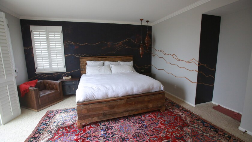 Ceballos' Rocky Mountain range sketch on Chris and Hayley Filasky's master bedroom walls has special significance. The couple met in Vail, Colo.