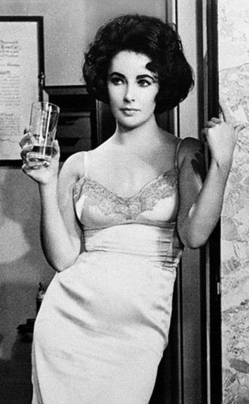 """Elizabeth Taylor made a statement in a slip dress in 1961's """"Butterfield 8."""" The costume designer for the film was Helen Rose."""