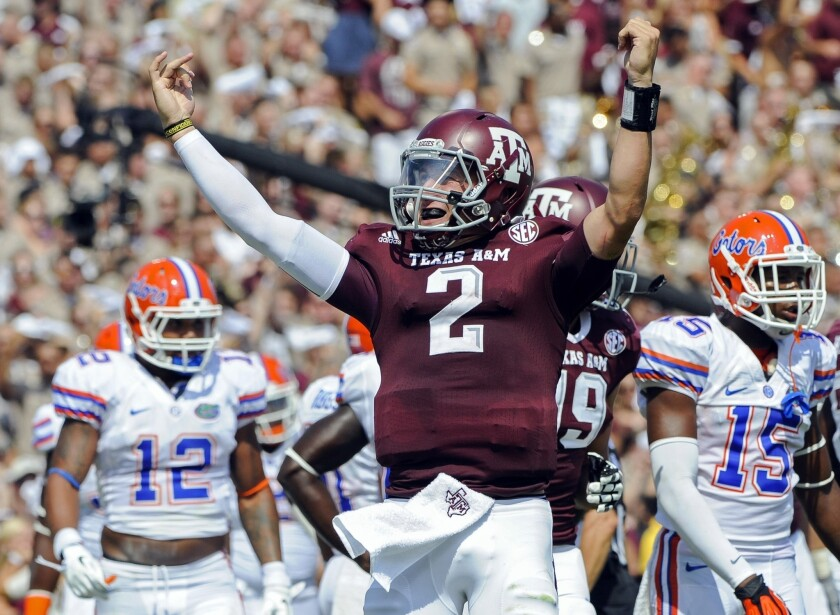 Texas A&M; quarterback Johnny Manziel is reportedly under investigation by the NCAA for signing autographs for money.