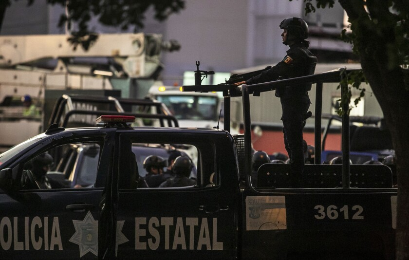 Eight killed in Mexico as cartel gunmen force authorities to release El Chapo's son