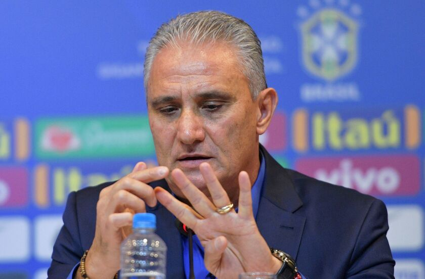 Brazil's national football team coach Tite gestures as he speaks during a press conference to announce his squad of players for the upcoming friendly matches against the U.S. and El Salvador, in Rio de Janeiro on August 17, 2018. - Brazil will face the US on September 7 and El Salvador on September 11.
