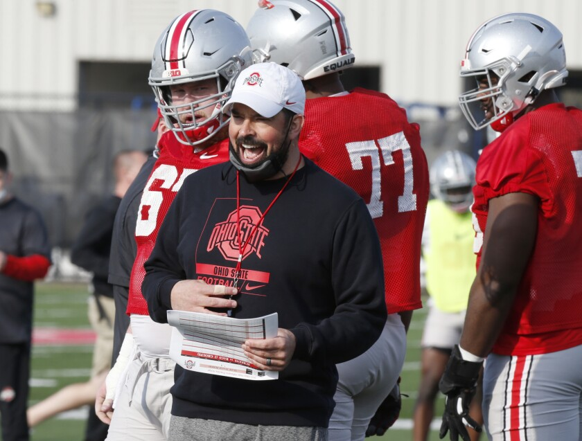 """FILE - Ohio State coach Ryan Day is seen during an NCAA college football practice in Columbus, Ohio, in this Monday, April 5, 2021, file photo. Third-year Ohio State coach Ryan Day opens a preseason camp for the first time without a good idea of who will be the starting quarterback. """"If I did, I'd probably sleep a little better right now, but I don't,"""" said Day, who is 23-2 in his first two seasons since taking over for Urban Meyer. (AP Photo/Paul Vernon, File)"""