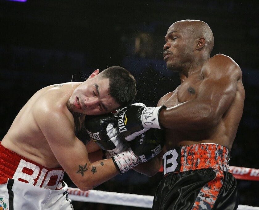 Timothy Bradley, right, hits Brandon Rios during a WBO welterweight title bout Saturday, Nov. 7, 2015, in Las Vegas. (AP Photo/John Locher)