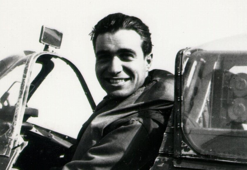 Steve Pisanos sits in his Spitfire after a mission over France in 1942.