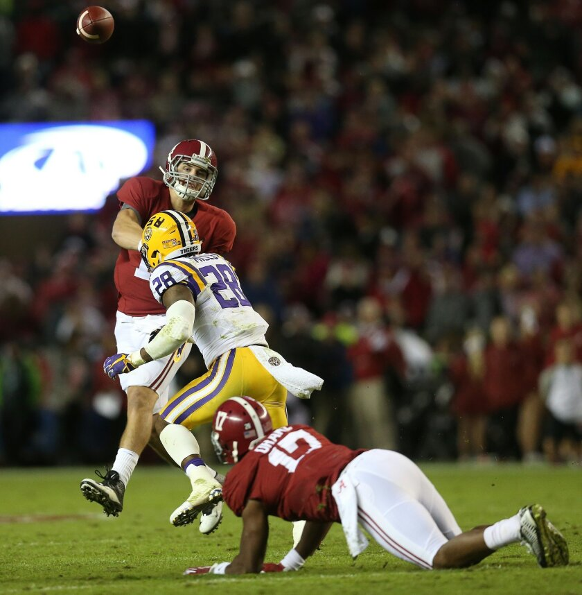 Alabama quarterback Jake Coker (14) passes the ball against LSU in the first half of an NCAA college football game Saturday, Nov. 7, 2015, in Tuscaloosa , Ala. (AP Photo/John Bazemore)
