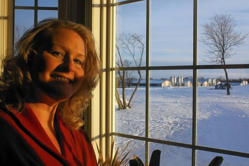 From her window, Angela Hostetler can see the barns where her family raises chickens. The Hostetlers estimate they'll spend $70,000 to heat the barns this winter, more than twice as much as it cost last year.