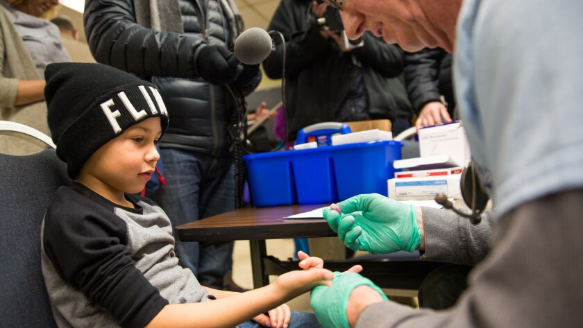 Grayling Stefek has his blood drawn as part of a lead screening campaign in Flint, Mich., in January.