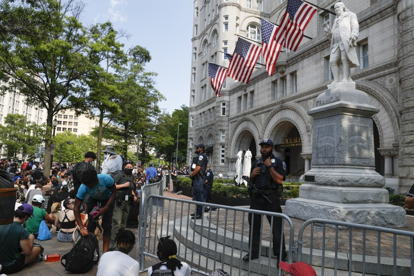 Demonstrators protest the death of George Floyd, Wednesday, June 3, 2020, at Trump International Hotel on Pennsylvania Avenue in Washington. Floyd died after being restrained by Minneapolis police officers. (AP Photo/Jacquelyn Martin)