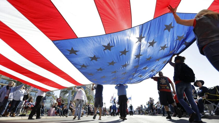 SAN DIEGO, CA 11/11/2017: Members of the Knights of Columbus carry a large American flag along the H