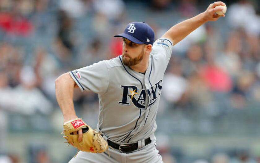 Adam Kolarek pitches for the Tampa Bay Rays against the New York Yankees on June 19 in New York.