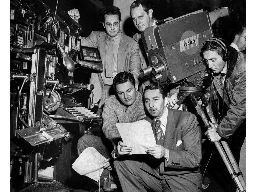 Jan. 18, 1951: A film crew from KTTV-TV lines up a shot of a Linotype machine in the Los Angeles Times composing room.