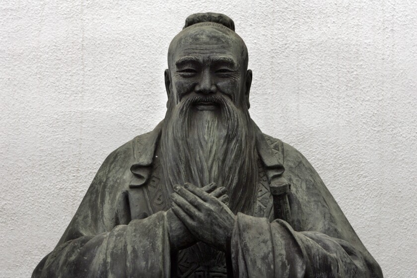 detail from a sculpture of Confucius