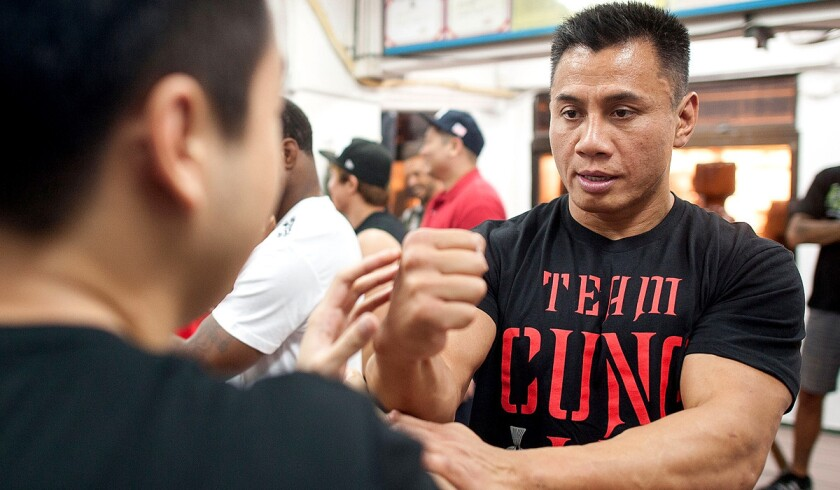 UFC middleweight fighter Cung Le practices Wing Chun during a training session in Hong Kong before his bout against Michael Bisping this summer.