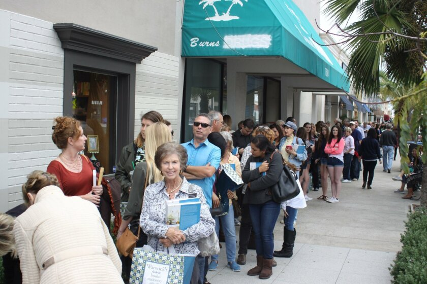 The line for the Scott brothers booksigning runs down Girard Avenue.