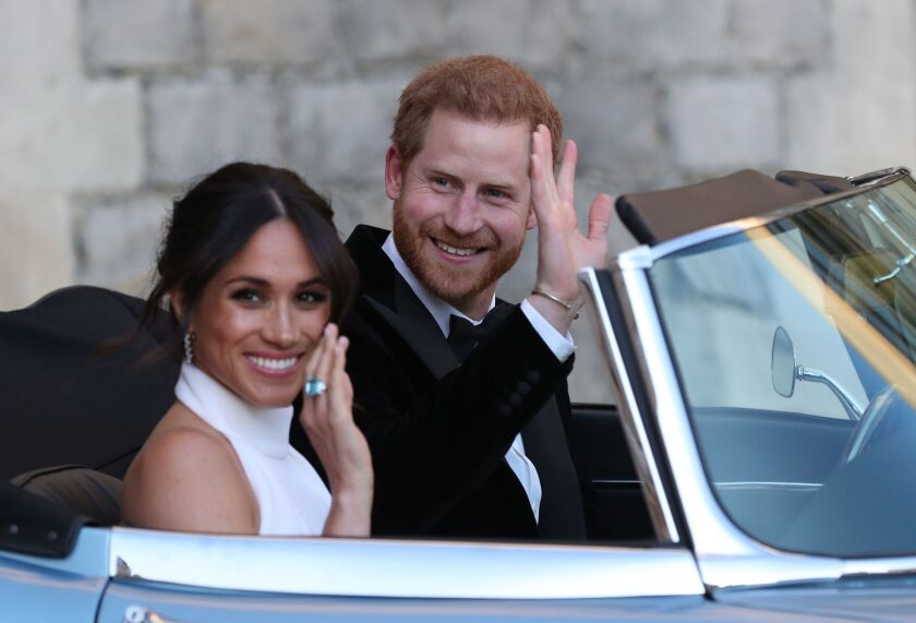 Britain's Prince Harry, Duke of Sussex, and Meghan Markle, Duchess of Sussex, leave Windsor Castle