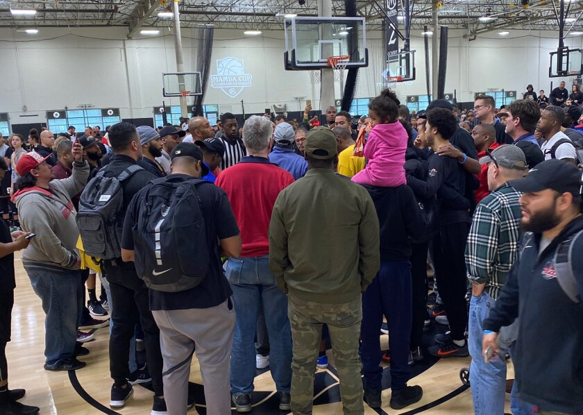 People gather on one of the basketball courts at the Mamba Sports Academy in Thousand Oaks after learning of Kobe Bryant's death in a helicopter crash in Calabasas on Jan. 26, 2020.