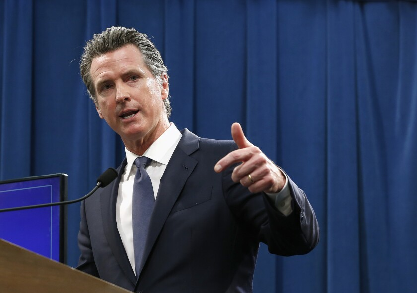 Gov. Gavin Newsom discusses his revised 2019-20 state budget during a news conference in May.